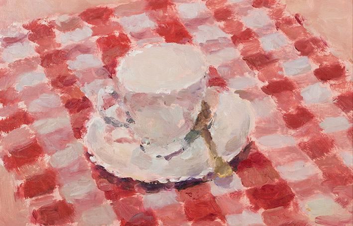 Teacup on Red and White Table Cloth
